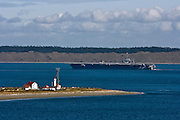 U.S. Navy carrier John C. Stennis passing Point Wilson, Fort Worden State Park, Port Townsend, Washington