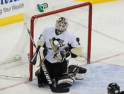 Dec 30, 2009; Newark, NJ, USA; Pittsburgh Penguins goalie Brent Johnson (1) makes a save during the third period at the Prudential Center. The Devils defeated the Penguins 2-0.