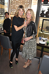 Left to right, ASSIA WEBSTER and KELLY COOPER BARR at a lunch at the Brompton Asian Brasserie, 223-225 Brompton Road, London on 2nd May 2013.