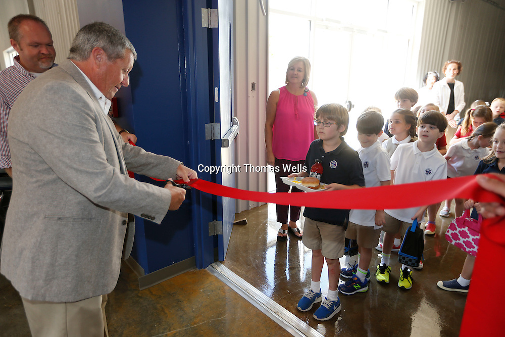 Thomas Wells | Buy at PHOTOS.DJOURNAL.COM<br /> Elelmetary students at Tupelo Christian Prepatory School wait intently as the school's Headmaster Ronnie Hill officially opens the schools new dinning hall Tuesday.