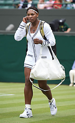 25.06.2011, Wimbledon, London, GBR, Wimbledon Tennis Championships, im Bild Serena Williams (USA) walks on court wearing a cardican during the Ladies' Singles 3rd Round match on day six of the Wimbledon Lawn Tennis Championships at the All England Lawn Tennis and Croquet Club, EXPA Pictures © 2011, PhotoCredit: EXPA/ Propaganda/ *** ATTENTION *** UK OUT!