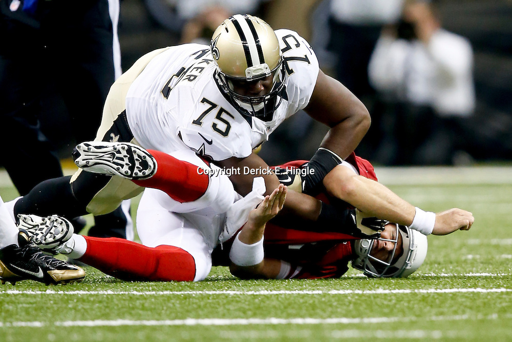 Sep 22, 2013; New Orleans, LA, USA; New Orleans Saints defensive end Tyrunn Walker (75) against the Arizona Cardinals during a game at Mercedes-Benz Superdome. The Saints defeated the Cardinals 31-7. Mandatory Credit: Derick E. Hingle-USA TODAY Sports