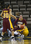 February 10 2011: Minnesota Golden Gophers forward Jackie Voigt (45) looks to pass as Minnesota Golden Gophers guard Kiara Buford (30) looks on during the first half of an NCAA women's college basketball game at Carver-Hawkeye Arena in Iowa City, Iowa on February 10, 2011. Iowa defeated Minnesota 64-62.