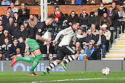 Fulham Striker, Ross McCormack (44) powering away from Bristol City defender, Aden Flint (4) during the Sky Bet Championship match between Fulham and Bristol City at Craven Cottage, London, England on 12 March 2016. Photo by Matthew Redman.