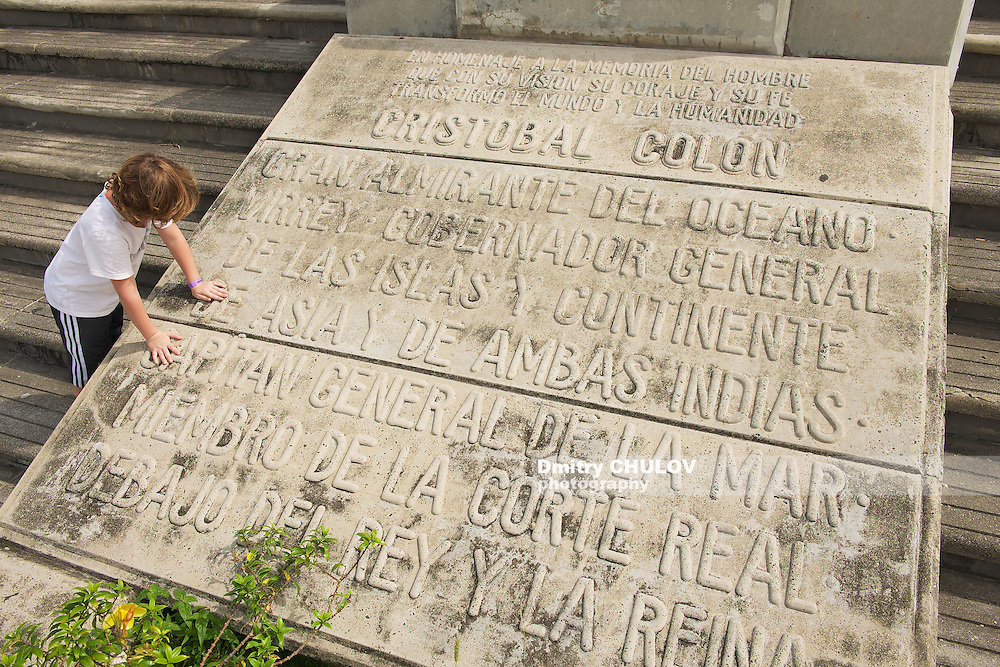 SANTO DOMINGO, DOMINICAN REPUBLIC - NOVEMBER 08, 2012: Unidentidied kid reads the Memorial plaque at the entrance to the Columbus Lighthouse in Santo Domingo, Dominican Republic.