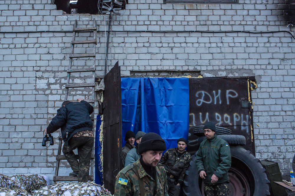 PISKY, UKRAINE - NOVEMBER 17, 2014: Members of the Ukrainian army stand outside the abandoned building being used as their base in the fight against pro-Russia rebels for control of the Donetsk airport, in Pisky, Ukraine. CREDIT: Brendan Hoffman for The New York Times