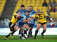 Chris Eaton tries to tackle Blues halfback Alby Mathewson. Super 15 rugby match - Hurricanes v Blues at Westpac Stadium, Wellington, New Zealand on Friday, 30 April 2011. Photo: Dave Lintott / photosport.co.nz