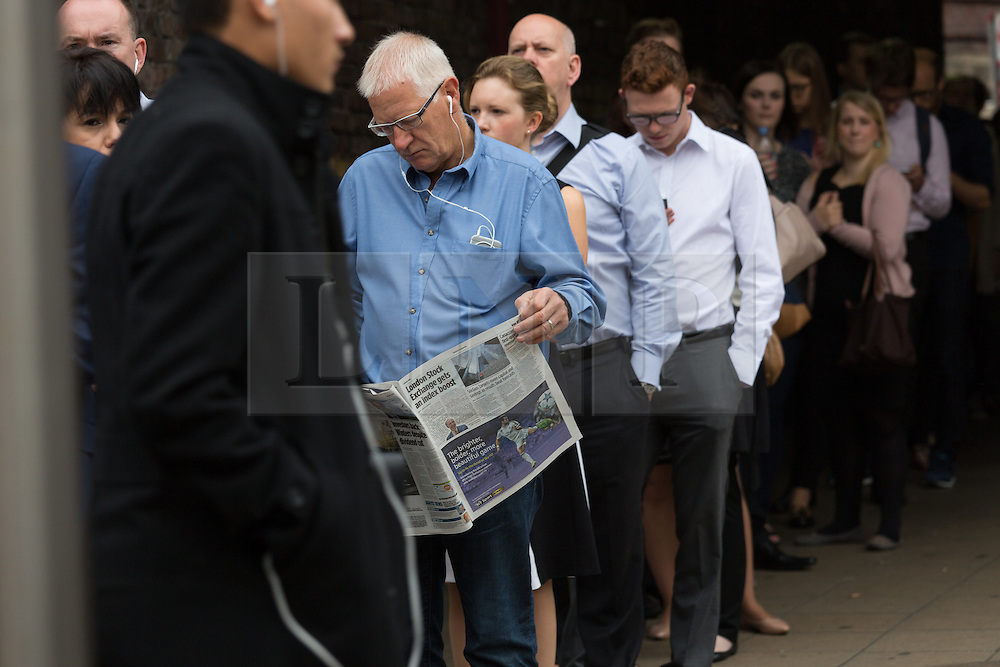 © Licensed to London News Pictures. 06/08/2015. London, UK. People queue for busses at Waterloo station in London. A tube strike today has closed the TfL London Underground network as members of four unions take industrial action for the second time in a month because of a deadlocked dispute over plans to launch a new all-night tube train service next month. Extra busses have been laid on to help commuters get to work. Photo credit : Vickie Flores/LNP