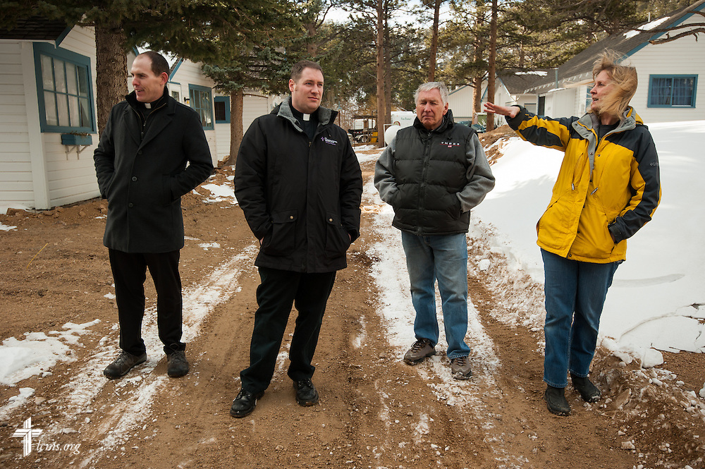 (L-R) The Rev. Seth Clemmer, pastor of Mt. Calvary Lutheran Church, the Rev. Michael W. Meyer, manager of LCMS Disaster Response, and Mt. Calvary Elder Dean Pedersen, listen as Deyn Johnson, owner of Whispering Pines Cottages on the River, talks about her flood-damaged business in Estes Park, Colo., on Tuesday, Jan. 7, 2014. LCMS Communications/Erik M. Lunsford