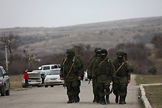 MAR 04 2014 Armed men patrol outside a Ukrainian military unit