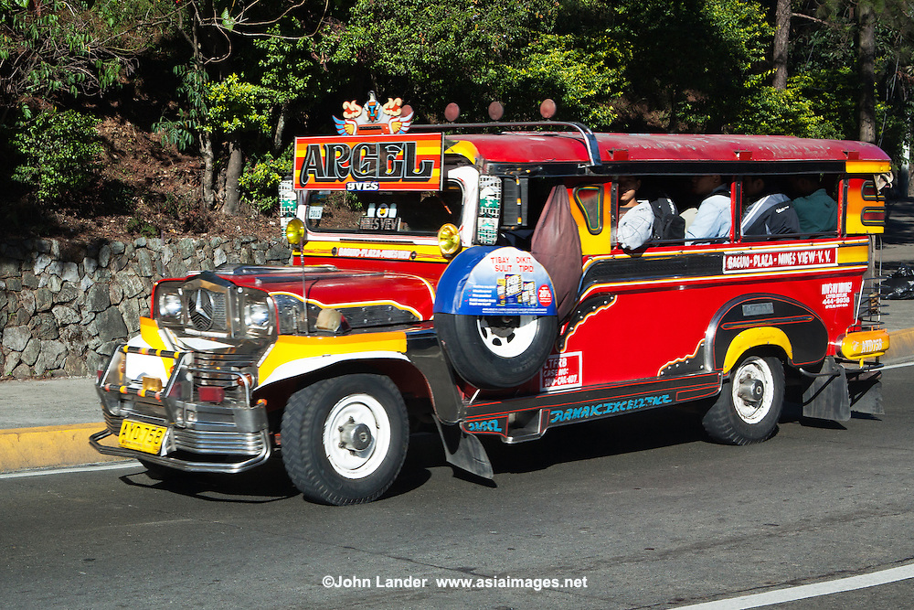 "Jeepneys are a popular means of public transportation in the Philippines and were originally made of abandoned US army jeeps left behind after World War II.  Jeepneys are known for flamboyant decorations and funny names given by their owners such as ""One Love"".  They have become almost a symbol of Filipino culture and ingenuity. The word Jeepney derives from a combination of jeep and jitney. At the end of WWII jeepneys were stripped down, metal roofs were added for shade; and they were decorated with vibrant colors and ornaments."