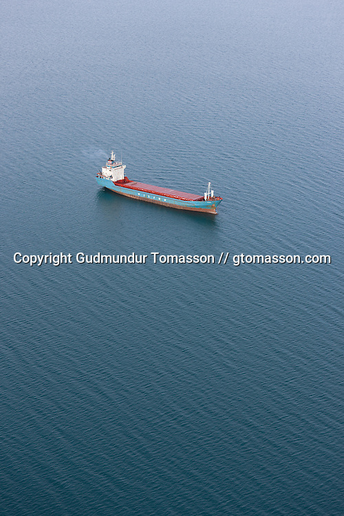 The cargo ship Wilson Mingo at anchor in the fjord Hvalfjörður, Iceland.