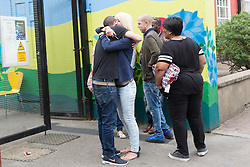 © Licensed to London News Pictures.05/08/2015. London, UK. People outside the Kids Company Centre in Kenbury Street, south east London today about the closure of the youth charity, the Kids Company led by Camila Batmanghelidjh. The Kids Company has been hit by financial impropriety and sex abuse claims. Photo credit : Vickie Flores/LNP