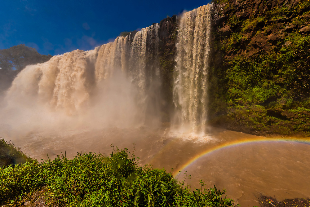 """The Blue Nile Falls is a waterfall on the Blue Nile river in Ethiopia. It is known as Tis Abay in Amharic, meaning """"great smoke"""". It is situated on the upper course of the river, about 30 km downstream from the town of Bahir Dar and Lake Tana."""