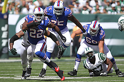 Sept 9, 2012; East Rutherford, NJ, USA; Buffalo Bills running back Fred Jackson (22) breaks a tackle by New York Jets linebacker Bart Scott (57) during the first half at MetLIfe Stadium.