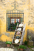 Gift shop in the Engadine Valley village of Guarda with old painted stone 17th Century buildings, Switzerland