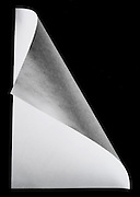 A white piece of paper floating above a black background
