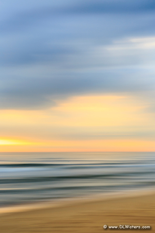 Moving the camera during exposure turns this Kitty Hawk beach scene into a kaleidoscope of colors.