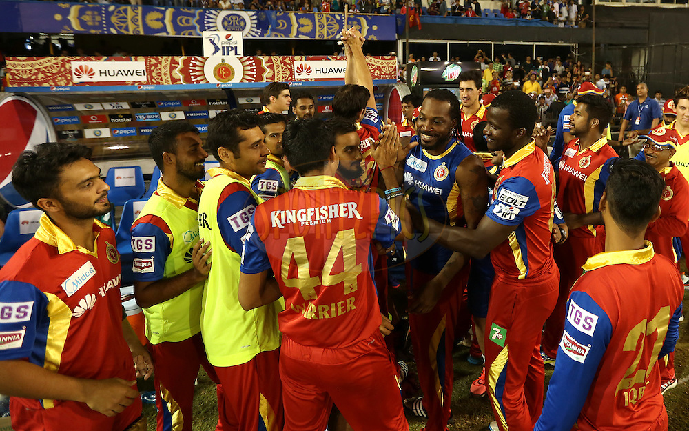 Royal Challengers Bangalore players celebrate after winning the match 22 of the Pepsi IPL 2015 (Indian Premier League) between The Rajasthan Royals and The Royal Challengers Bangalore held at the Sardar Patel Stadium in Ahmedabad , India on the 24th April 2015.<br /> <br /> Photo by:  Sandeep Shetty / SPORTZPICS / IPL