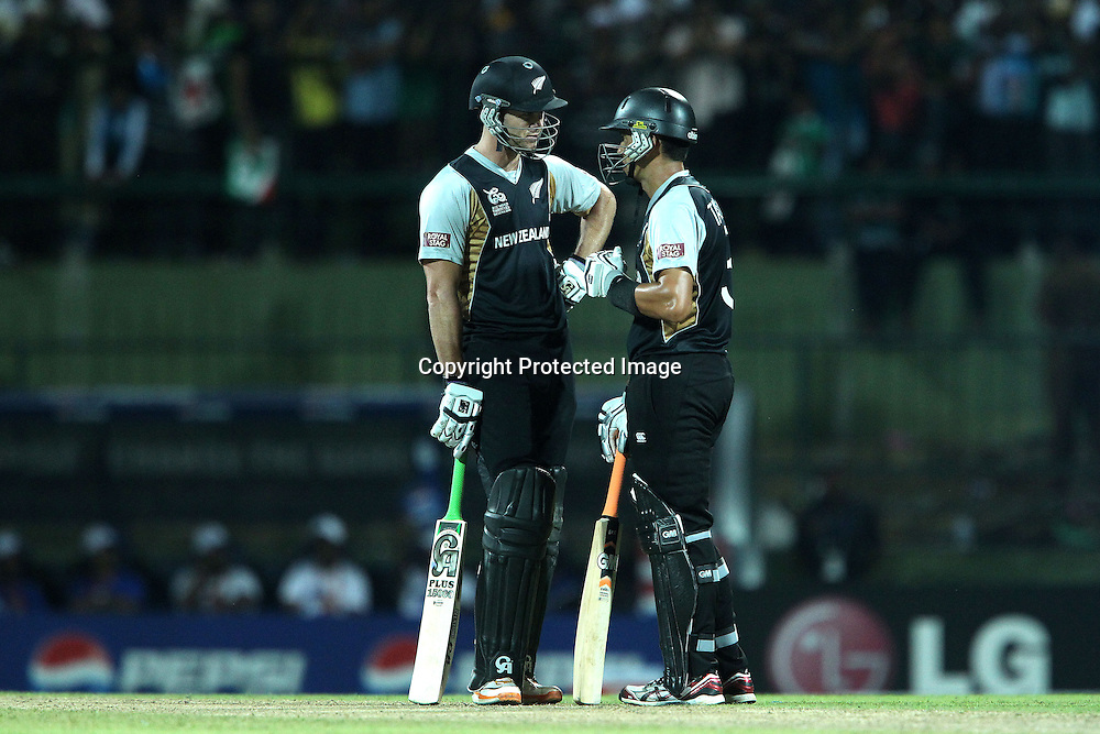 James Franklin and  Ross Taylor during the ICC World Twenty20 Pool match between Pakistan and New Zealand held at the  Pallekele Stadium in Kandy, Sri Lanka on the 23rd September 2012<br /> <br /> Photo by Ron Gaunt/SPORTZPICS/PHOTOSPORT
