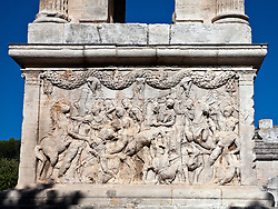 Detail on the base of a tower, dedicated as a memorial to the grandsons of Emperor Augustus Caesar, still stands in detailed glory at the ruins of Glanum, on the southern outskirts of St. Remy, Provence, France.
