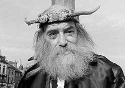 © Licensed to London News Pictures.01/11/15<br /> Whitby, UK. <br /> <br /> A man wearing a druid outfit and horns poses for a picture as hundreds of visitors attend the Whitby Goth weekend in Whitby, North Yorkshire. The event began in 1994 to celebrate goth culture and music and takes place twice each year. <br /> Thousands of extravagantly dressed people attend the popular event wearing Steampunk, Cybergoth, Romanticism, Victoriana and other clothing as they take part in the celebration of Goth culture. <br /> <br /> Note to Editors - Picture shot on Kodak Tri X 400ISO film.<br /> Photo credit : Ian Forsyth/LNP