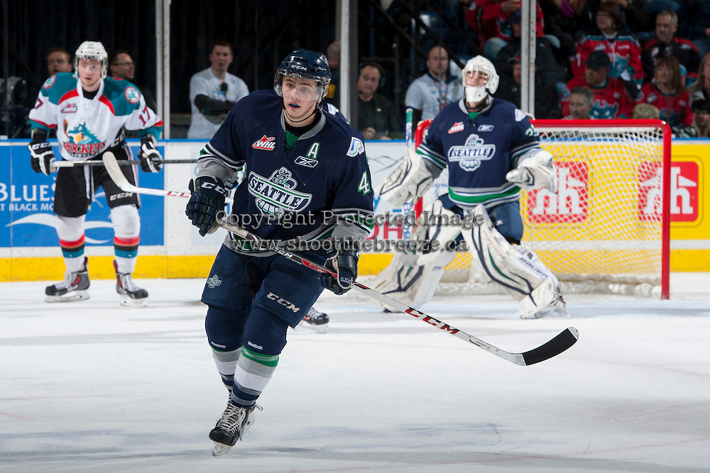 KELOWNA, CANADA - APRIL 5: Adam Henry #4 of the Seattle Thunderbirds skates against the Kelowna Rockets on April 5, 2014 during Game 2 of the second round of WHL Playoffs at Prospera Place in Kelowna, British Columbia, Canada.   (Photo by Marissa Baecker/Getty Images)  *** Local Caption *** Adam Henry;