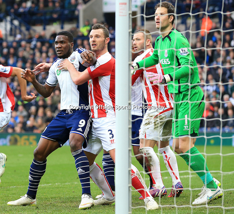 14th March 2015 - Barclays Premier League - West Bromwich Albion v Stoke City - Brown Ideye of West Bromwich Albion is held in the box by Erik Pieters of Stoke City - Photo: Paul Roberts / Offside.