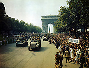 World War II 1939-1945: Crowds lining the Champs Elysees to view Allied tanks and half-tracks pass through the Arc du Triomphe, after Paris was liberated on August 25, 1944. France