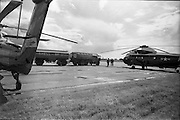 26/06/1963<br /> 06/26/1963<br /> 26 June 1963<br /> Irish Shell and BP fuel tankers for the helicopters of President John F. Kennedy under guard at Dublin Airport. View of one of the helicopters, a U.S. Army  Sikorsky VH-3A Sea King, being refuelled by a Shell and BP Leyland tanker.
