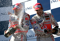 Melbourne. Australia - Sunday, March 18, 2007: Fernando Alonso and team-mate Lewis Hamilton (GBR, Vodafone McLaren Mercedes) celebrate on the podium at the opening Grand Prix of the Formula One World Championship in Australia.(Pic by Michael Kunkel/Propaganda/Hoch Zwei)