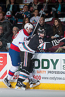 KELOWNA, CANADA - NOVEMBER 20: Brandon Baddock #13 of Edmonton Oil Kings checks Tomas Soustal #15 of Kelowna Rockets into the boards during first period on November 20, 2015 at Prospera Place in Kelowna, British Columbia, Canada.  (Photo by Marissa Baecker/Getty Images)  *** Local Caption *** Brandon Baddock; Tomas Soustal;