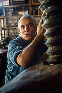 Bayir, Bozburun, Turkey, October 2015. A man in his working traditional olive oil press collection. Situated roughly between the seaside resorts of Marmaris and Bodrum and the Latmos mountains in the east lies Ancient Caria. The Carian Trail runs through pine scented forests along the coastal mountains of Western Turkey and is littered with ancient ruins, secluded coves with turquoise waters and little villages. more than 800km of ancient roads, shepherd paths and forest trails form Turkey's longest hiking trail. Photo by Frits Meyst / MeystPhoto.com