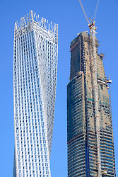 Detail of two skyscrapers, with one under construction, in Marina District of Dubai United Arab Emirates