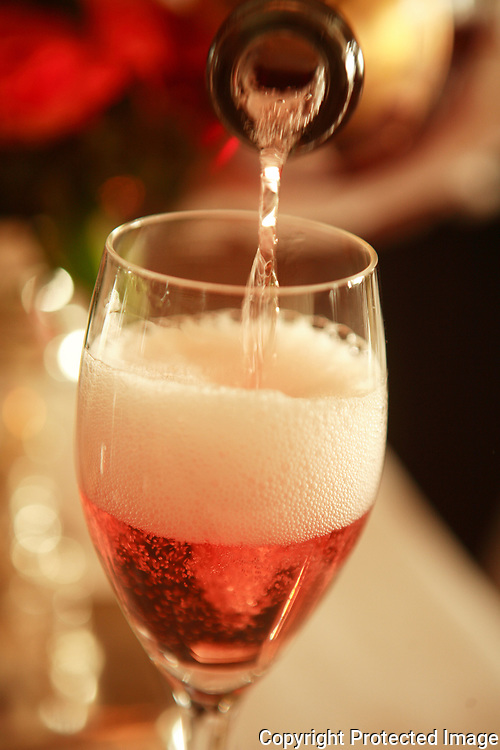 pouring pink champagne at the Michelin three star Restaurant Grand Vefour in Palais Royale,<br /> Paris