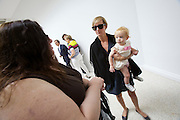 "54th Biennale of Venice..ILLUMInazioni - ILLUMInations.Giardini, American Pavillion..Jennifer Allora (holding baby) and Guillermo Calzadilla, ""Gloria"", 2011."