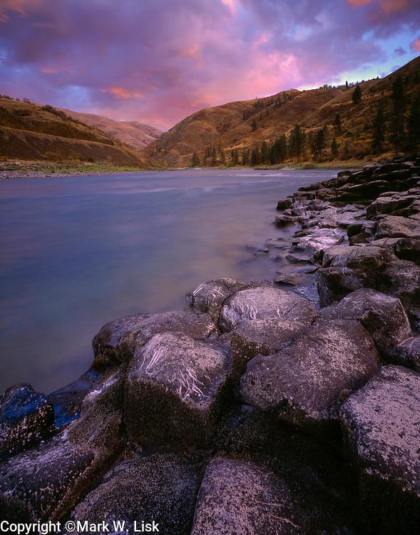 Ancient basalt columns apear at the edge of the Lower Salmon River, Idaho.