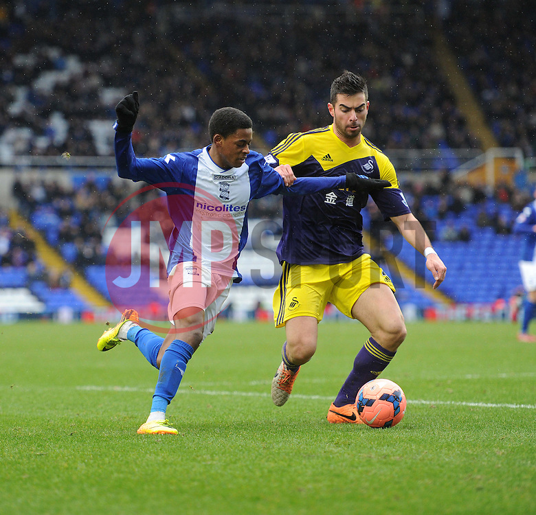 Birmingham City's Reece Brown looks to attack in the box under pressure from Swansea City's Jordi Amat - Photo mandatory by-line: Alex James/JMP - Tel: Mobile: 07966 386802 25/01/2014 - SPORT - FOOTBALL - St Andrew's - Birmingham - Birmingham City v Swansea City - FA Cup - Forth Round