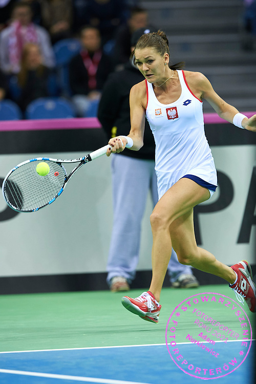 Agnieszka Radwanska from Poland in action during First Day of the Fed Cup / World Group 1st round tennis match between Poland and Russia at Tauron Krakow Arena on February 7, 2015 in Cracow, Poland.<br /> <br /> Poland, Cracow, February 7, 2015<br /> <br /> Picture also available in RAW (NEF) or TIFF format on special request.<br /> <br /> For editorial use only. Any commercial or promotional use requires permission.<br /> <br /> Adam Nurkiewicz declares that he has no rights to the image of people at the photographs of his authorship.<br /> <br /> Mandatory credit:<br /> Photo by &copy; Adam Nurkiewicz / Mediasport