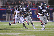 Ole Miss' Brandon Bolden (34) runs at Vaught-Hemingway Stadium on Saturday, November 27, 2010. Mississippi State won 31-23.