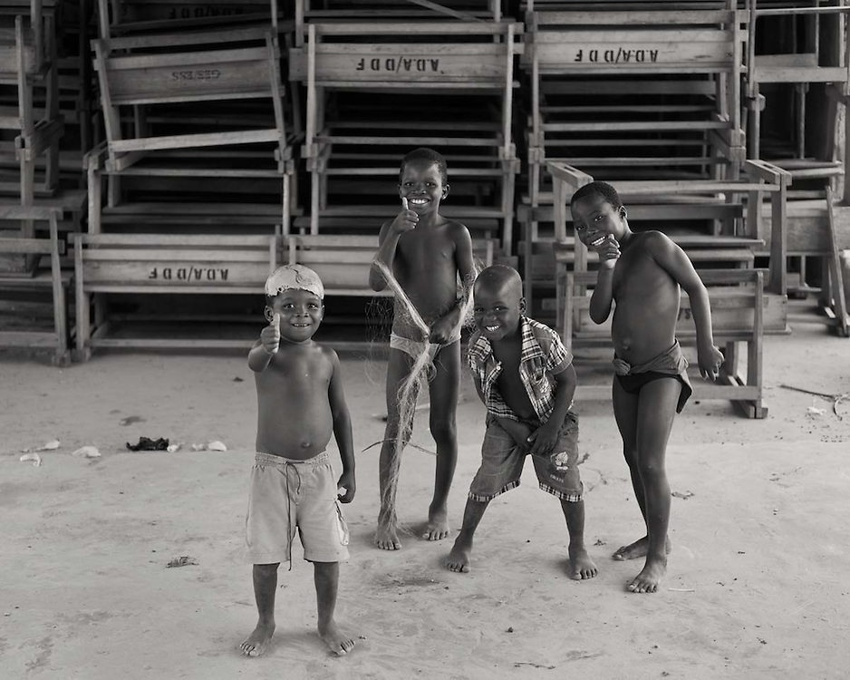 Kids posing in the school of a little fishing village on the banks of lake Volta