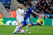 Leicester City forward Shinji Okazaki has a shot during the Barclays Premier League match between Leicester City and Swansea City at the King Power Stadium, Leicester, England on 24 April 2016. Photo by Alan Franklin.