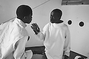 Mbayethiam and Aliounethiaw argue over a match result at a fencing studio in the city of Thiès, Senegal on May 2, 2015. Supported by OSIWA, organisation 'Pour un sourire d'enfant'  has implemented the sport of fencing as a form of restorative justice in a minor's prison for males and females in the city of Thiès, Senegal. This innovative judicial method works as a restorative rather than punitive approach to justice. Fencing is an effective method for helping incarcerated young people build self-confidence and respect (both for themselves and others), and engender discipline and determination.
