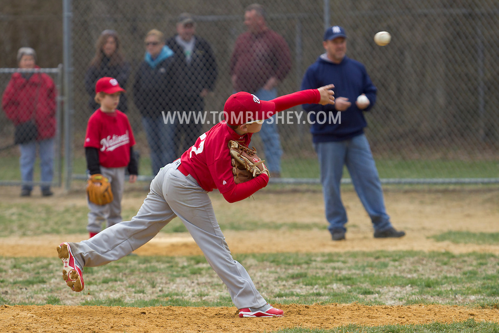 Montgomery , New York - A pitcher throws the ball toward home plate during a Little League baseball game on April 13, 2013.