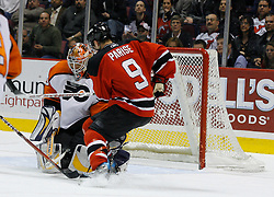 Mar 30, 2007; East Rutherford, NJ, USA; Philadelphia Flyers goalie Martin Biron (43) makes a save while New Jersey Devils left wing Zach Parise (9) looks for a rebound during the second period at Continental Airlines Arena in East Rutherford, NJ.