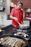 Eduardo Saez cooking at the Txoko Uri-Zarra in Bilbao, Spain.