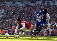 Photo: Olly Greenwood.<br />Arsenal v Blackburn Rovers. The FA Cup. 17/02/2007. Arsenal's Jeremie Aliadiere is tackled by Blackburn's Christopher Samba but no penalty is given.