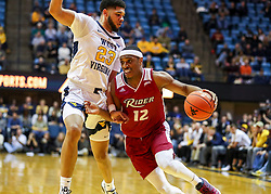 Nov 28, 2018; Morgantown, WV, USA; Rider Broncs guard Anthony Durham (12) drives against West Virginia Mountaineers forward Esa Ahmad (23) during the first half at WVU Coliseum. Mandatory Credit: Ben Queen-USA TODAY Sports