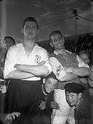13/08/1952<br /> 08/13/1952<br /> 13 August 1952 <br /> <br /> Harry Boland captain of Soccer team with Matty Clarke, Captain of Dundalk Soccer Team