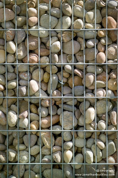 Wire gabions filled with pebbles. Beyond the Pale Garden.